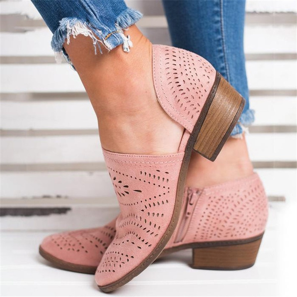concept of spring summer sale of shoes. Women's leg in