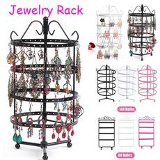 threerowsofornamentsonthewall, jewelryorganizerstand, jewelrystanddisplay, Joyería